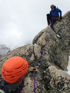 Josh Jackson belays in Ron Paproski  toward the summit of Disappointment Peak